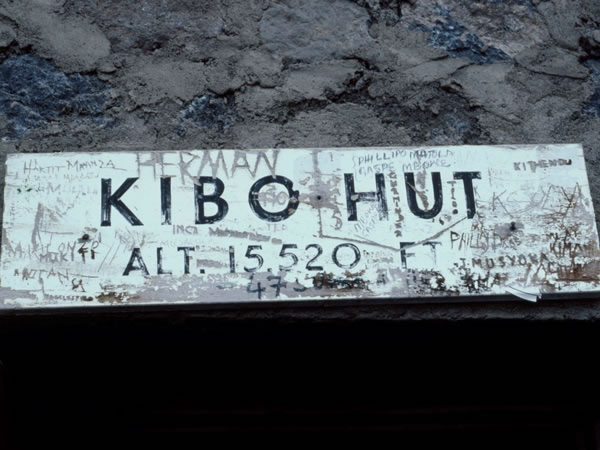 11.12.1985 - A sign on the side of Kibo hut (15,520 feet is 4,730 metres).